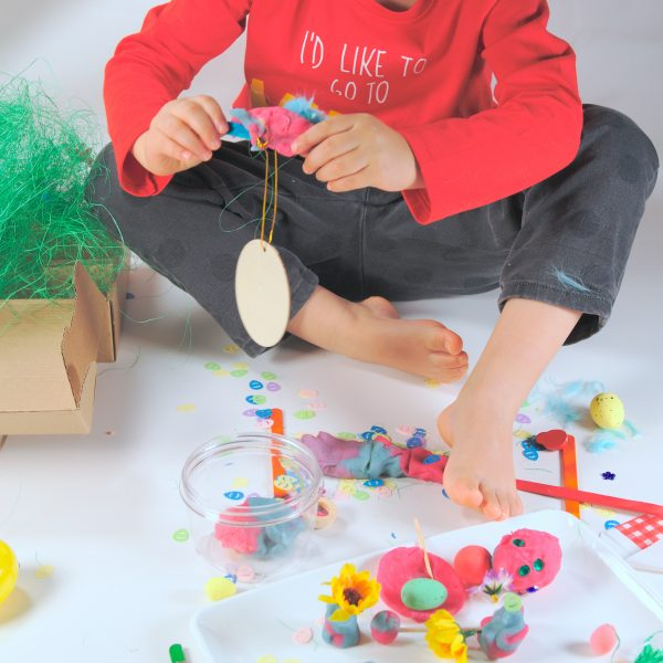 A child playing with Artboom's EGGxtremely Good Play Dough Kit
